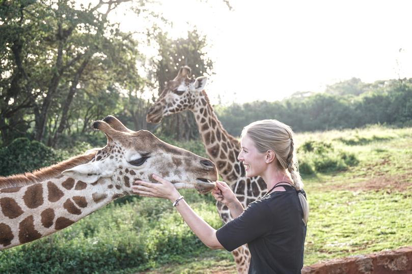 Julia petting Giraffe